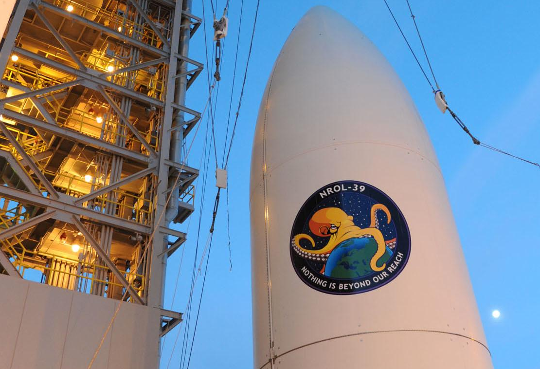 Rocket launched into space with octopus mission patch logo